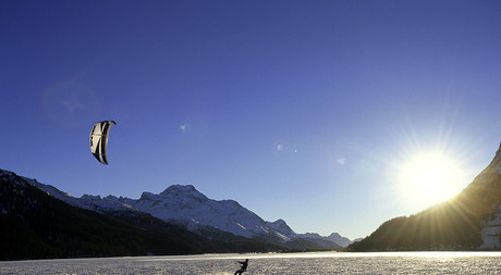 Snowkiting on the Lake Silvaplana in Engadin