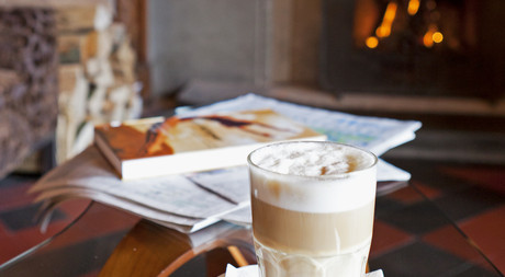 Latte Macchiato and magazines at Hotel Castell in St. Moritz